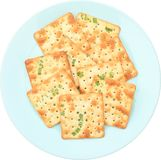 Vegetable cracker. The row of vegetable crackers are on the blue plate Stock Photos