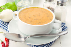 Vegetable cream bowl on wooden table Stock Images