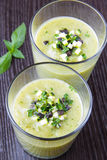 Vegetable cream soup with avocado, herbs, zucchini and black oli Stock Photo