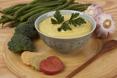 Vegetable cream soup with broccoli, green beans, garlic, parsley Stock Images
