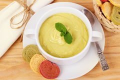 Vegetable cream soup with broccoli, green beans, mint and bread Stock Photos