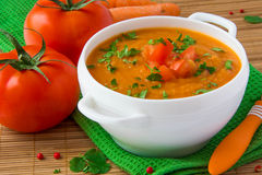 Vegetable cream soup with parsnip, carrots and tomatoes Royalty Free Stock Photography