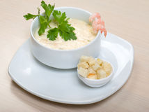Vegetable cream soup with prawns Royalty Free Stock Images