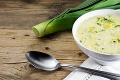 Vegetable cream soup in a white ceramic bowl on wood Royalty Free Stock Photography