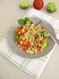 Vegetable crumble with carrots, tomatoes, broccoli and parmesan crumbs Royalty Free Stock Photography