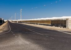 Vegetable cultivation almeria, spain. Street with two cars in the distance Royalty Free Stock Images