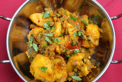 Vegetable Curry. Overhead view of Bombay Aloo vegetable curry royalty free stock images
