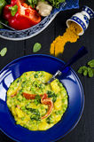 Vegetable curry. With potato, with spinach, green peas and red pepper royalty free stock image