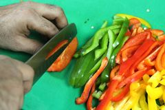 Vegetable cutting on a green board royalty free stock photography