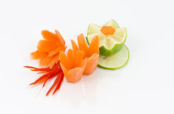 Vegetable decoration. Made of carrot, chilli, carved lime to flower Royalty Free Stock Image