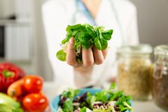 Vegetable diet nutrition and medication concept. Nutritionist of. Fers healthy vegetables diet stock image