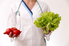 Vegetable diet nutrition and medication concept. Nutritionist offers healthy vegetables diet Stock Photography