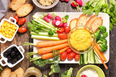 Vegetable and dip. On wood background Stock Photos