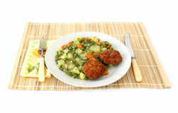 Vegetable dish. With fork and knife and wooden tablecloth full isolated picture royalty free stock images