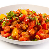 Vegetable dish. Bean, carrot, tomatoes Stock Images