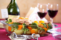 Vegetable dish with wine. Hot vegetable dish with bottle of wine stock photography
