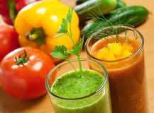 Vegetable drink. Healthy drink, vegetable juice, red and green Royalty Free Stock Images