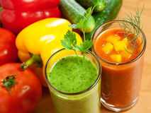 Vegetable drink. Healthy drink, vegetable juice, red and green Royalty Free Stock Photo