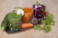 Vegetable drinks from cucumbers, carrots and beets. Stock Photo