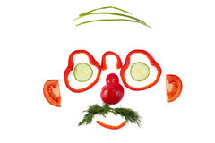 Vegetable face. Funny face made from vegetable pieces stock images