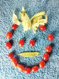Vegetable face. Funny face made with vegetables Stock Photos