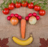 Vegetable face photographed on a Jute fabric a vegetable market.  stock image