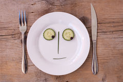 Vegetable Face on Plate - Male, Neutral, looking d stock photography