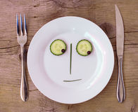 Vegetable Face on Plate - Male, Sceptical stock photography