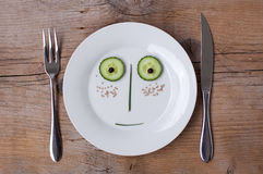 Vegetable Face on Plate - Male, Surprised Stock Photo