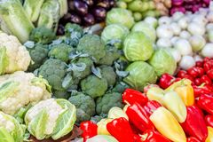 Vegetable farmer market counter. Colorful heap of various fresh organic healthy vegetables at grocery store. Healthy natural food. Background royalty free stock photo