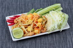 "Vegetable festival as  spicy papaya salad with mixed vegetable call ""Som Tum J"" is organic food served. Vegetable festival ,spicy papaya salad as Stock Photography"