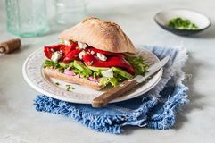Vegetable and Feta Sandwich. Beetroot Hummus, Roasted Sweet Pepper, Avocado and Feta Sandwich royalty free stock photos