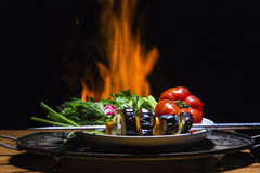 Vegetable and   flame on background. Vegetable with campfire on background Stock Photos