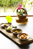 Vegetable food. Four dishes of delicate vegetable food with the daisies on the background Stock Photos