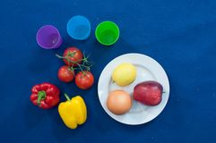 Vegetables and fruits are an important part of a healthy diet, and variety is as important. Vegetable food, red pepper, yellow bell pepper, cherry tomatoes Stock Photos
