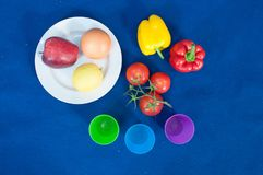 Vegetables and fruits are an important part of a healthy diet, and variety is as important. Vegetable food, red pepper, yellow bell pepper, cherry tomatoes Royalty Free Stock Image
