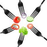 Vegetable on fork Stock Images