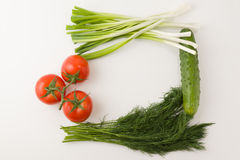 Vegetable frame. Ripe vegetables lie on a white table forming a square frame Stock Image