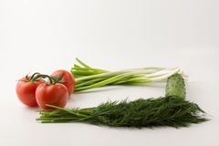 Vegetable frame. Ripe vegetables lie on a white table forming a square frame Royalty Free Stock Photography