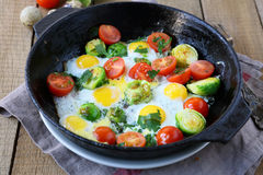Vegetable fried eggs in a frying pan Stock Photography