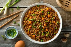 Vegetable Fried Rice. Delicious vegetable fried rice with egg, carrot, garlic, green peas and scallions Stock Photos