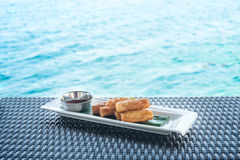 Vegetable fried spring rolls on water background Stock Image