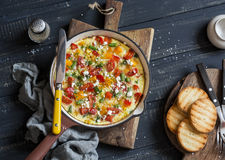 Vegetable frittata in a cast iron skillet on wooden background. Delicious brunch Stock Photos