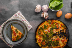 Vegetable frittata in oven Royalty Free Stock Photography