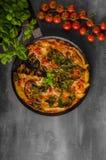 Vegetable frittata in oven Stock Photo