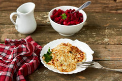 Vegetable fritters made of cabbage, rice. And beetroot salad on wooden background. Healthy, vegetarian food Stock Photography