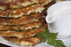 Vegetable fritters of zucchini with parsley and dill closeup  . Royalty Free Stock Photos