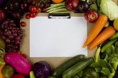 Vegetable and fruit on clipboard with paper Stock Image