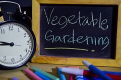 Vegetable gardening on phrase colorful handwritten on blackboard.