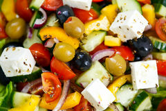 Vegetable Greek Salad with Feta cheese, black and green olives, cherry tomatoes, yellow pepper, red onion, cucumber. Royalty Free Stock Photo